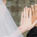 Bride and Groom Looking at Their Rings